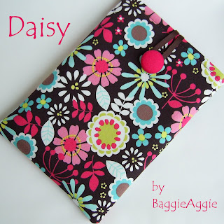 Handmade Kindle or Kobo case in a contemporary floral fabric and lined in lipstick pink.