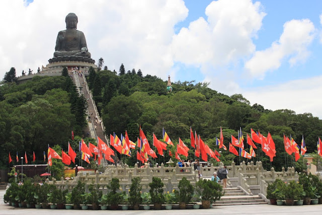 The Big Buddha statue (Tian Tan Buddha) can be seen on top of the mountain of Po Lin Monastery at Ngong Ping Village in Hong Kong