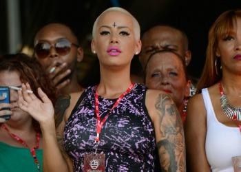 Illuminati satanism rumors amber rose gets forehead for Cross tattoo on forehead meaning