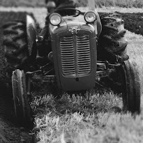 The 'face of a vintage tractor at a ploughing exhibition