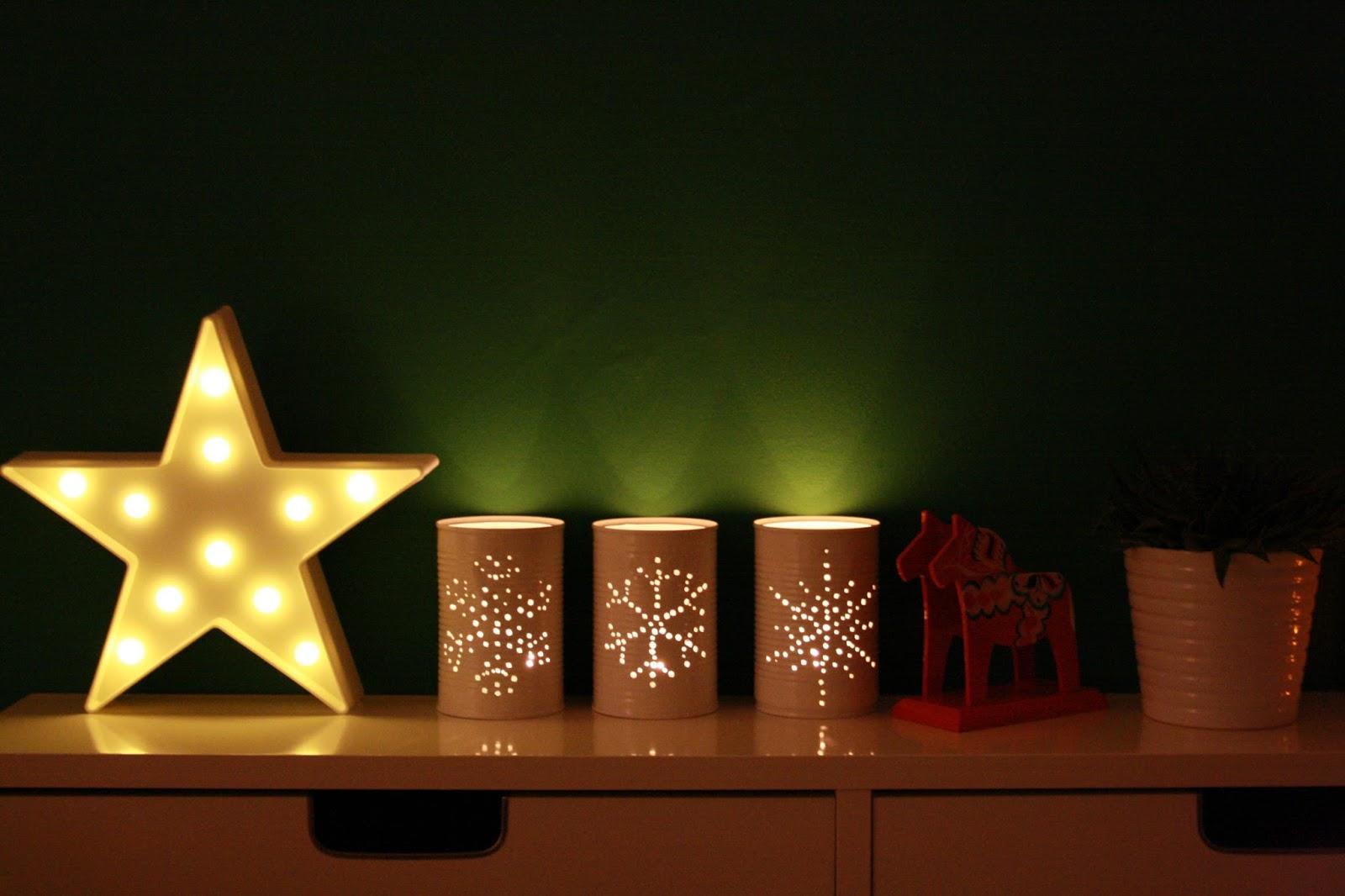 tin lighting. tin can tea light holders