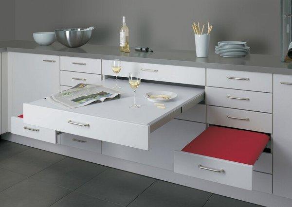 Mesa y asientos integrados en los muebles de cocina. | Revista ...
