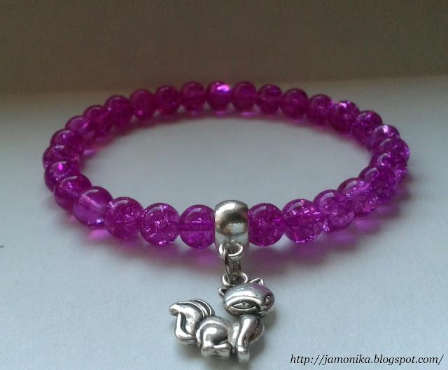 Różowa bransoletka z zawieszką kotkiem