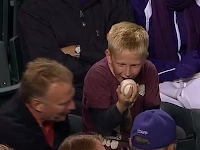 Young Rockies fan excited to receive foul ball