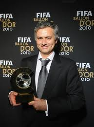Jose Mourinho holds Ballon d'Or trophy with his hands