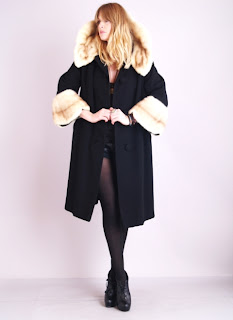 Vintage 1950's black wool swing coat with white mink scalloped collar and cuffs.