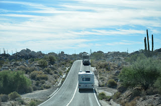 RV's driving south through cactus country.