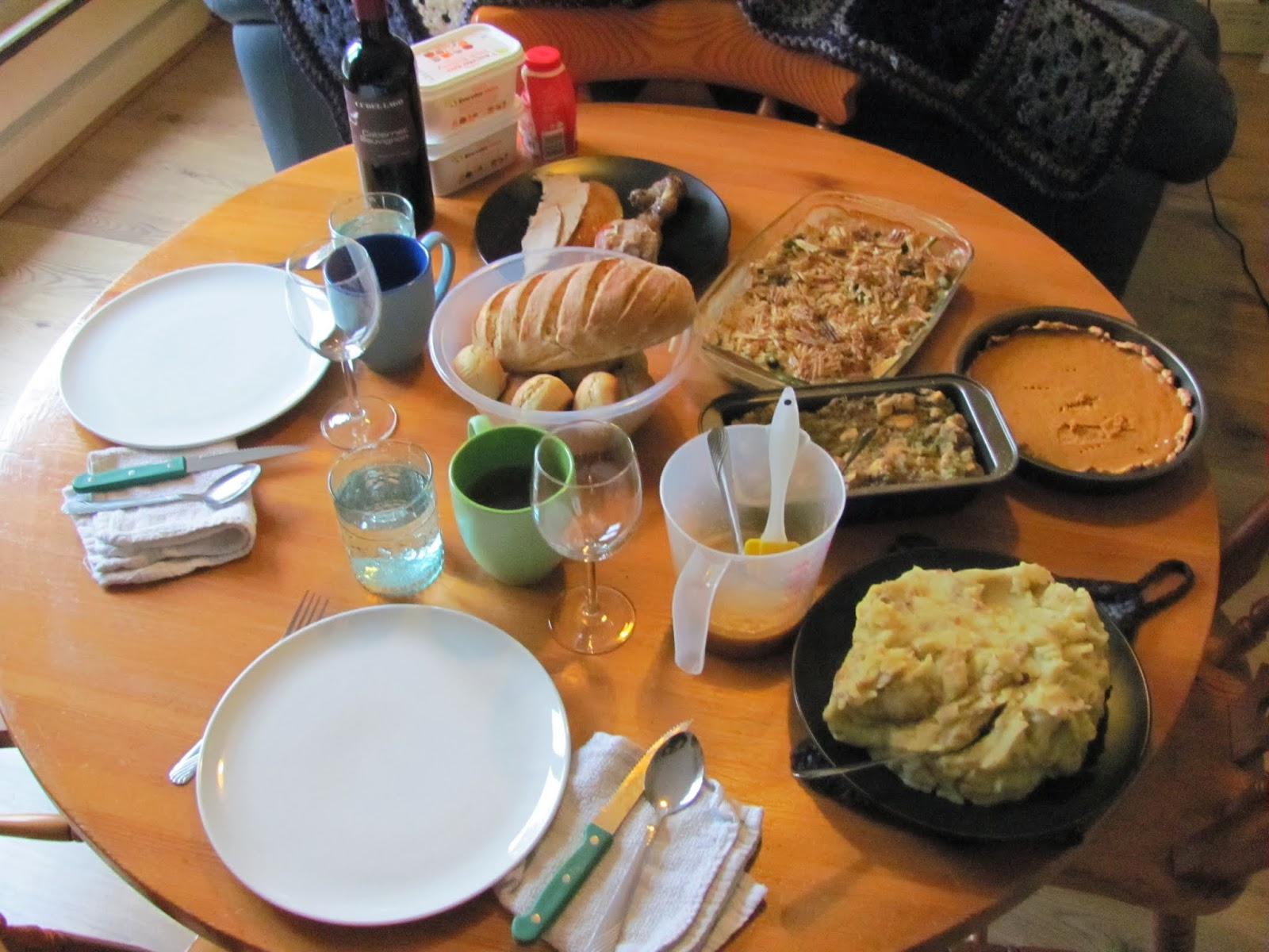 The table is laid out with potatoes, casserole, stuffing, pie, and turkey in Dublin Ireland Thanksgiving 2013