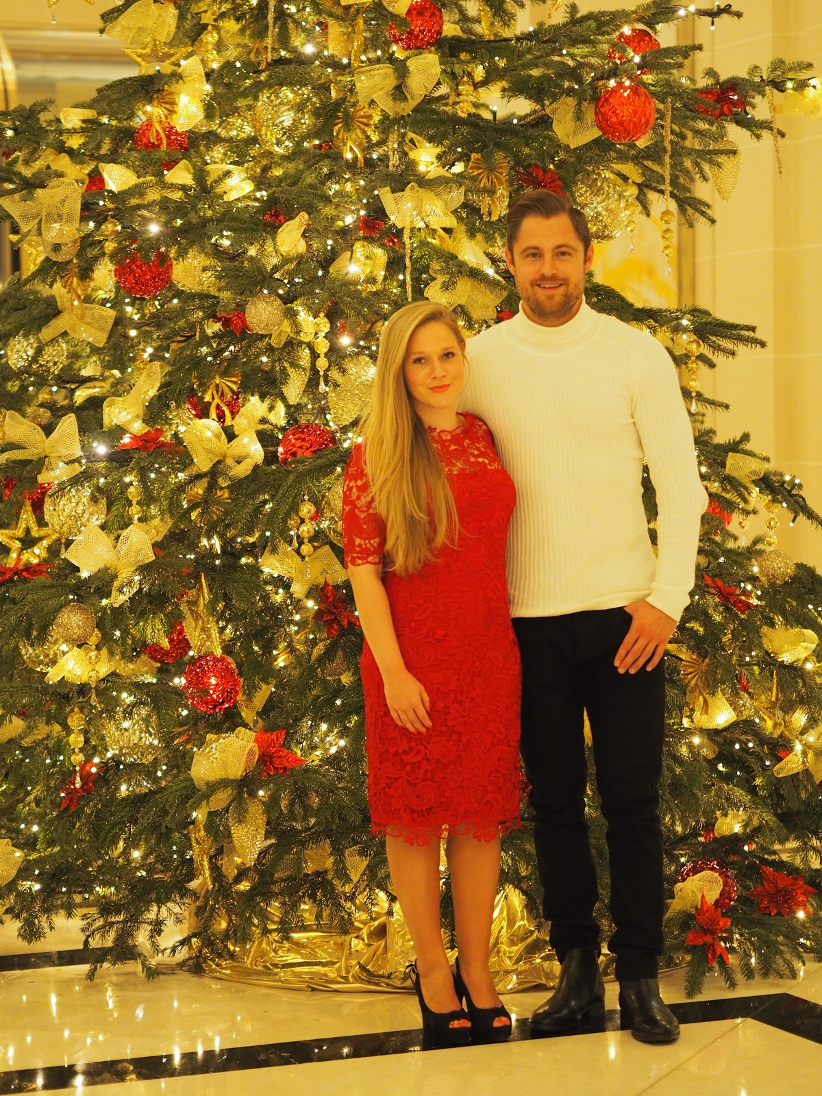 Couple, Katie Matthews and Ben Heath, Kalanchoe, standing by Christmas Tree at Peninsula Hotel Paris