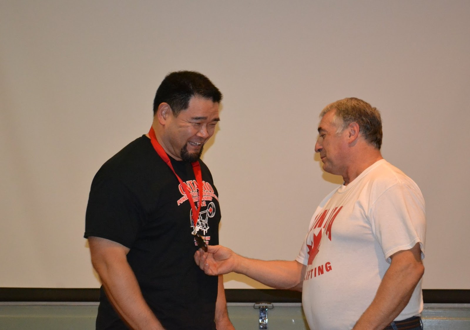 getting a medal from Jerry Marentette
