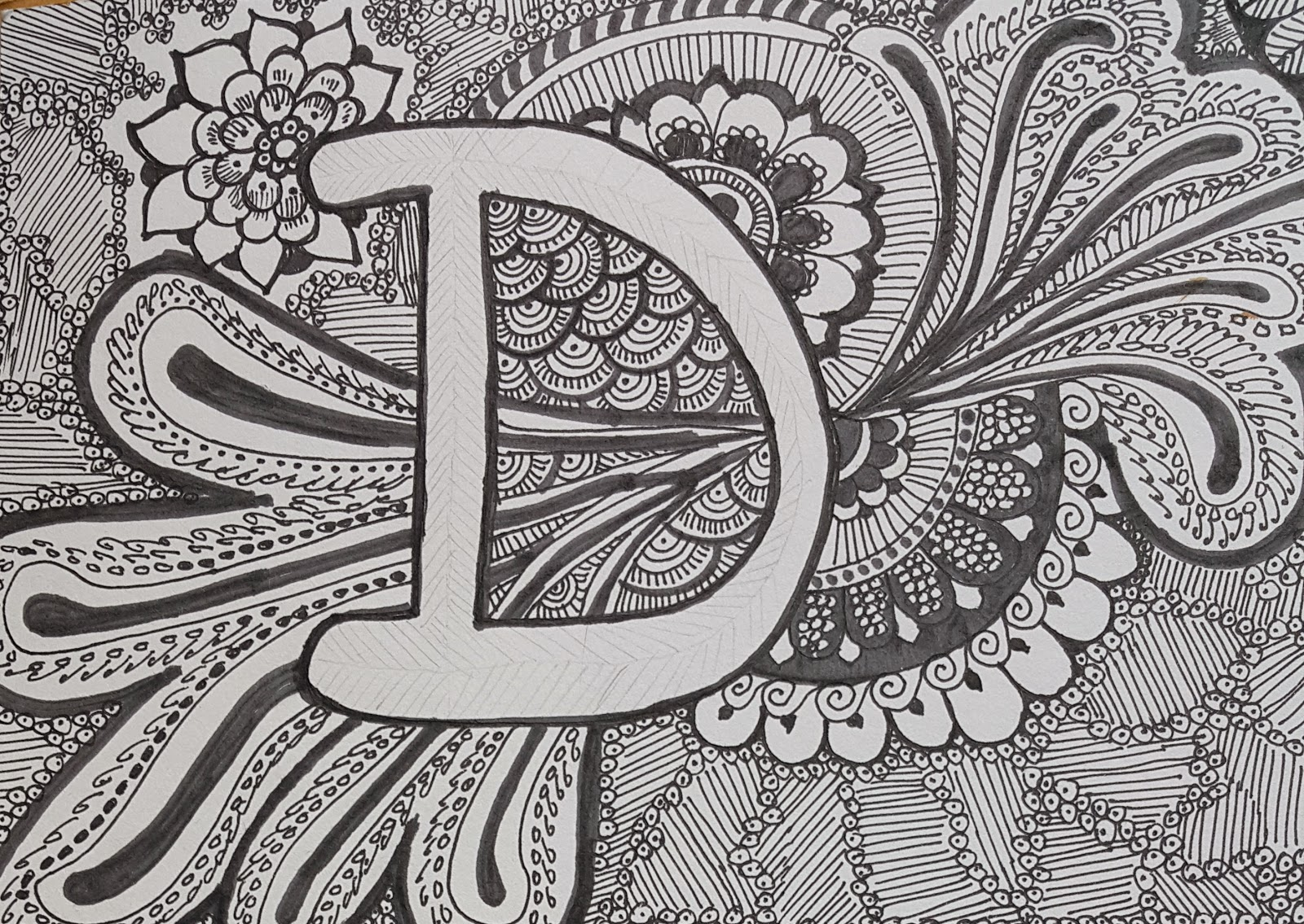 Close up of name in doodles