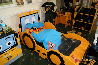 Ben all snuggled up in the JCB bed, JCB Kids