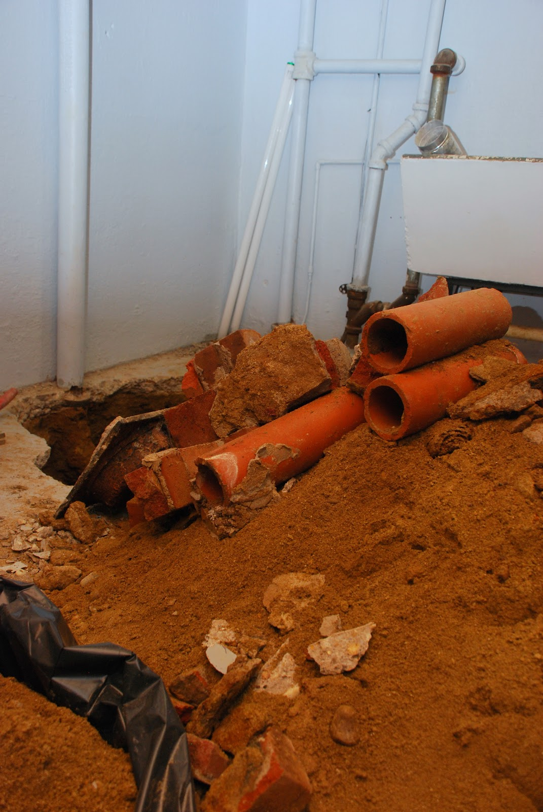 Our little beehive becoming handy through home renovation cooking - The Guys Were So Efficient With The Demo That They Were Able To Break The Concrete Floor And Dig Down To All Our Plumbing Including The Floor Drain