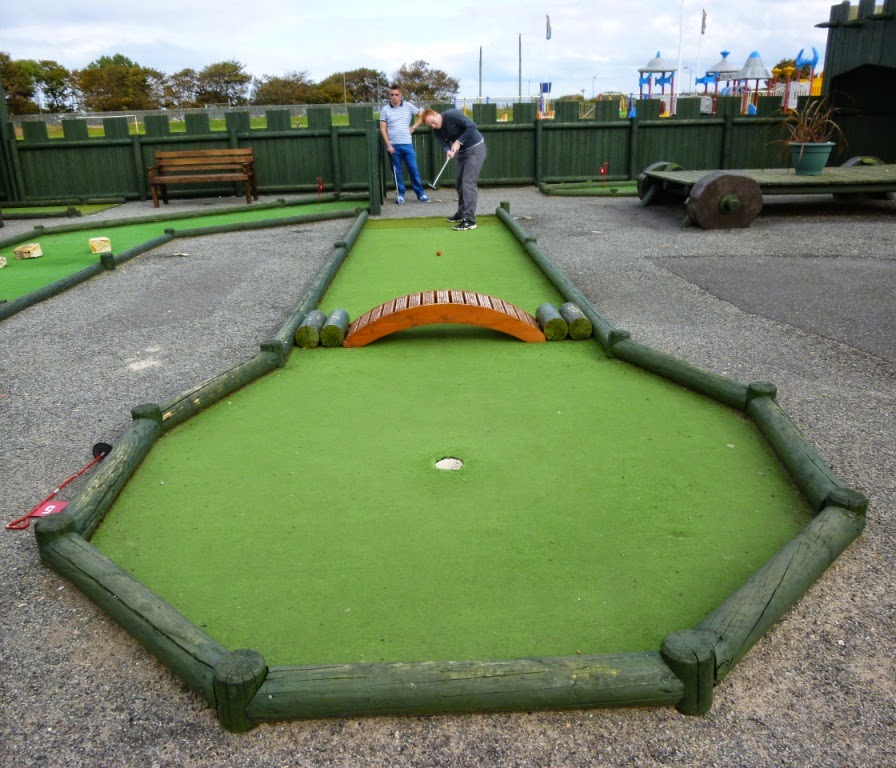 Seth playing hole 1 of the Crazy Golf course at Pontin's Prestatyn Sands Holiday Park