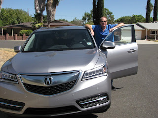 Acura's MDX has racy looks, earnest oomph