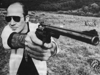 Hunter S. Thompson holding what appears to be a .44 Magnum