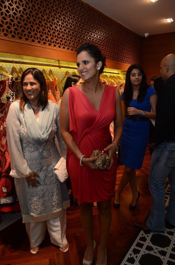 Elegant Sania mirza looking beautiful in red dress