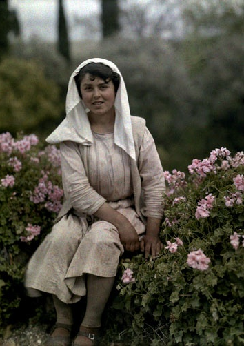 Woman sitting in a garden of flowers, Corfu; 1920's by Maynard Owen Williams #autochrome #garden #woman