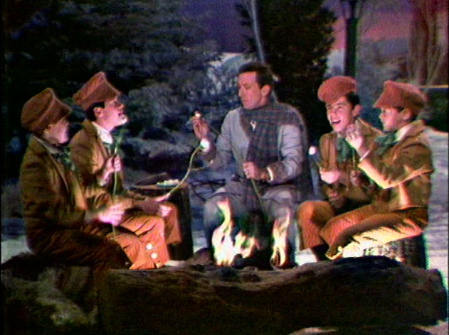 williams with the osmond brothers in a christmas show that features the boys singing while toasting marshmallows around an open fire - Andy Williams Christmas Show
