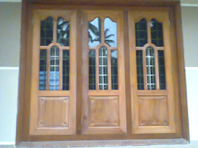 Kerala style carpenter works and designs wooden window for Window glass design in kerala