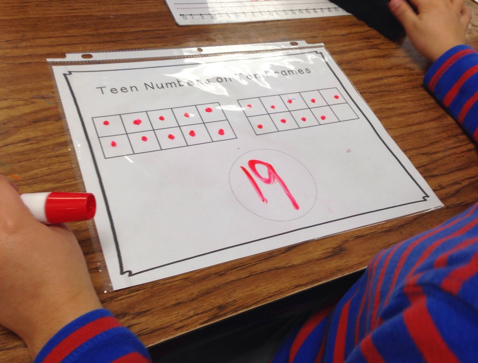 we practiced filling in ten frames to show teen numbers