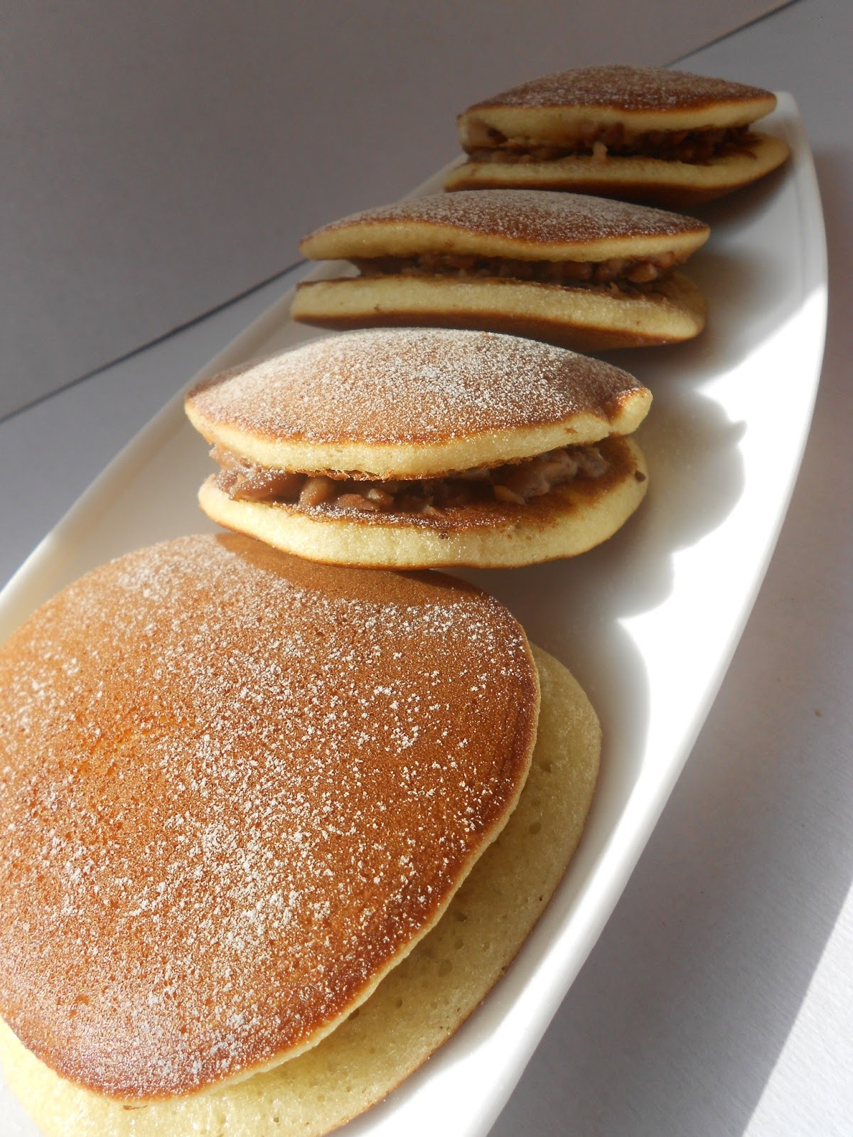 Dorayaki - typically a pancake sandwich filled with sweet beans paste ...