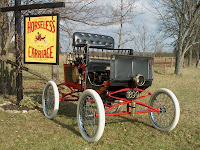 image Horseless Carriage Museum sign and Antique Automoblie