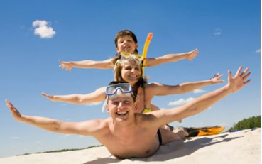 travel, summer vacation at the beach, family beach, father to his children on the beach, children at the beach, in the sand, beach vacation, father and children playing on the beach, playing with the sand, beach holidays, family playing, travel tips