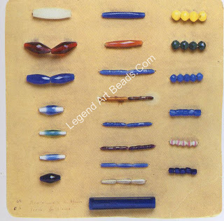Beads traded in Africa for slaves. Top left bead: length, 5.2 cm