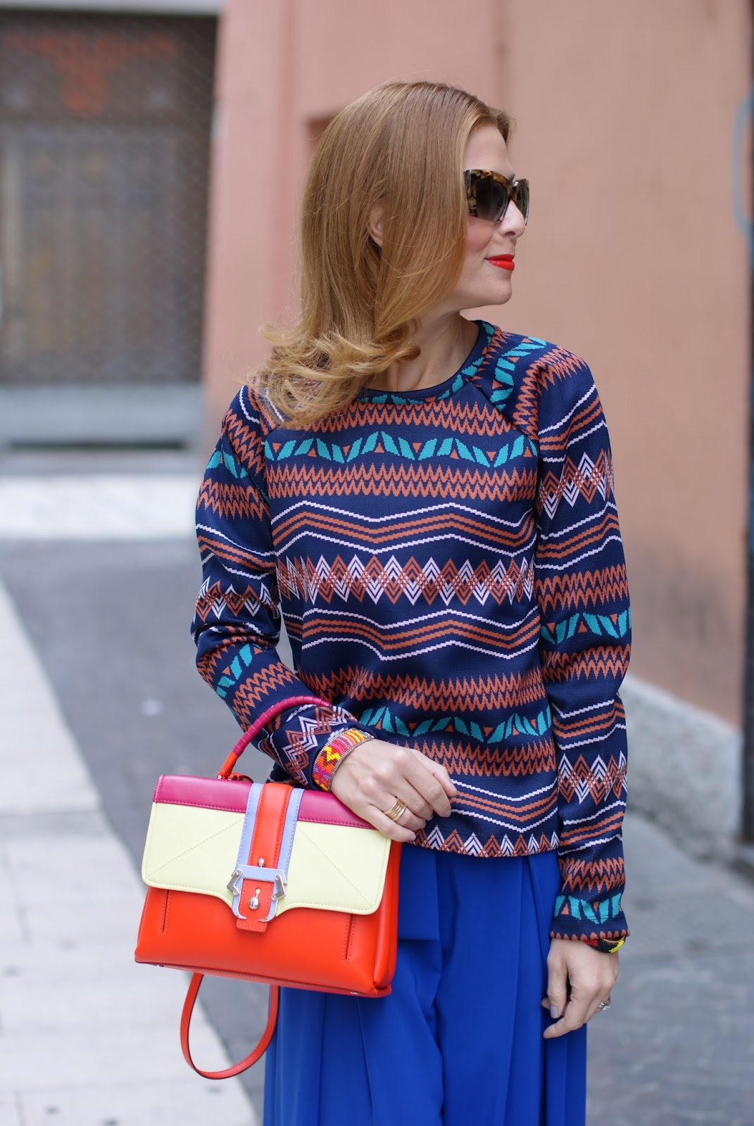 Colorful outfit with wide leg palazzo pants, Zara sweatshirt and Paula Cademartori Petite Faye bag on Fashion and Cookies fashion blog, fashion blogger style