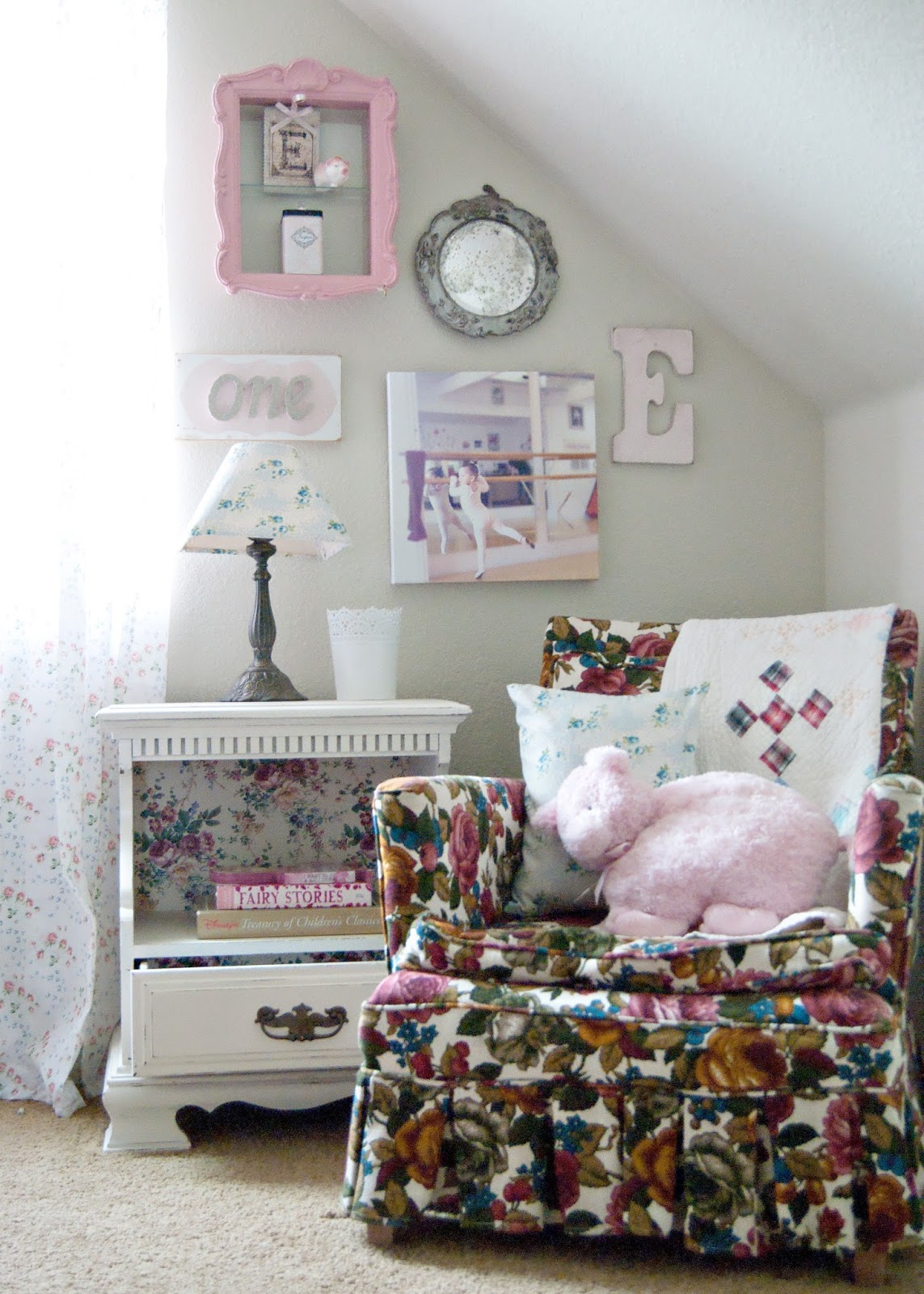 Reading corner - granny chic chair and vintage nightstand framed by gallery wall