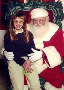 funny picture: girl pees in her pants by Santa