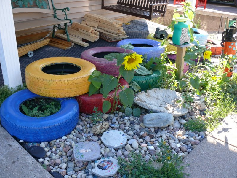 Upcycled crib and finally finished painted tires child - Painted tires for gardens ...