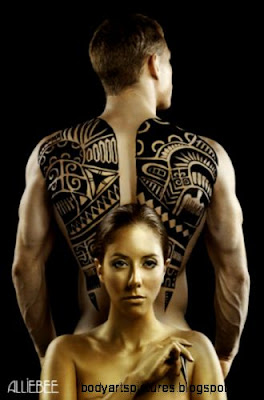 Gold Polynesian back piece  West island of Montreal based henna