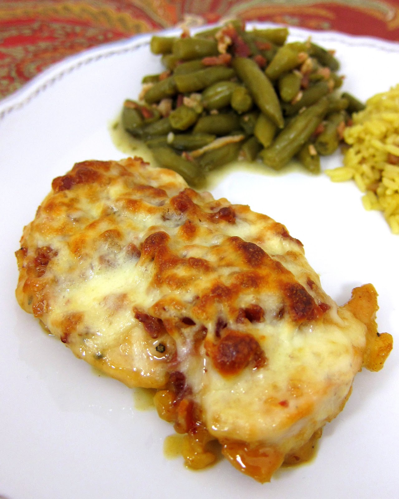 Cheesy Honey Mustard Chicken - TO DIE FOR!!! Chicken topped with honey, mustard, lemon juice, paprika, lemon pepper, bacon, Mozzarella and baked. Ready in under 30 minutes. We ate this two nights in a row. It is that good. Even picky eaters love this!