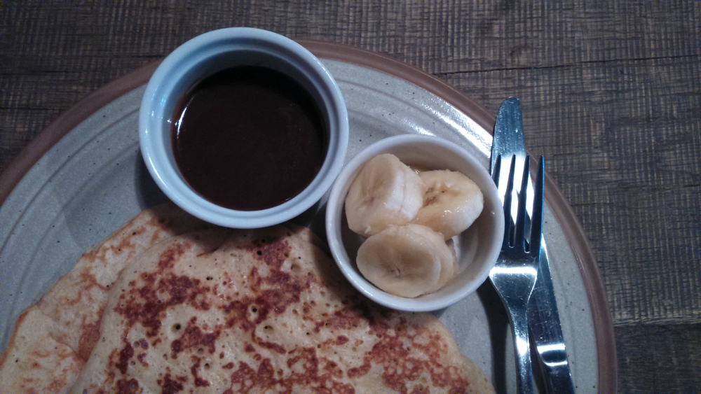 Pancakes with chocolate sauce and bananas at Rye and Soda restaurant, Aberdeen