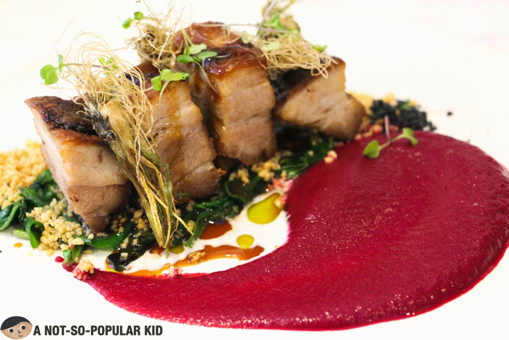 The amazing roasted pork belly with beetroot sauce in The Girl + The Bull