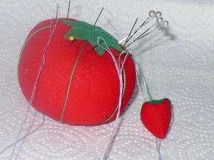 my bright red pin cushion