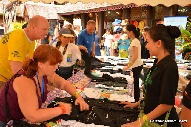 Volunteer tending to customers at the souvenir stall