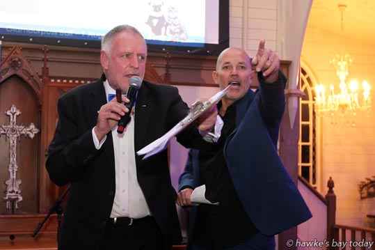 L-R: Kim Shannon, auctioneer, Harcourts Real Estate; Kevin Waggs, MC, pointing out a bid - SPCA and Harcourts Glamourpuss Ball and Charity Auction, fundraising event for Hastings SPCA and Napier SPCA, at The Old Church, Meeanee, Napier. photograph