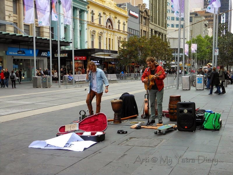 A band of musicians, on the streets of Melbourne