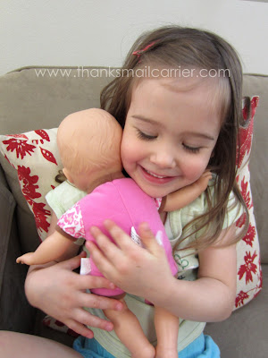 hugging baby doll
