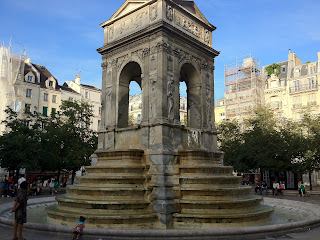An intricate fountain in the Marais area of Paris