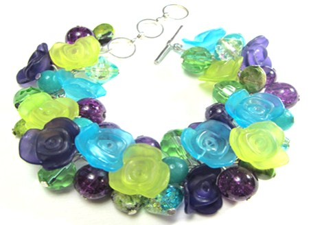 Chunky bracelet has purple and green flower buttons with Fire Polished Czech Beads, Sea Sediment Jasper, Aquamarine and crackle beads