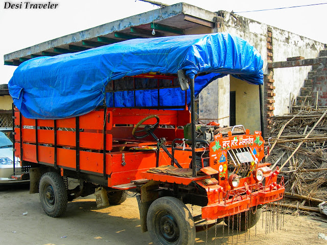 A colorful Jugaad 4 wheeler used to take produce to take to market