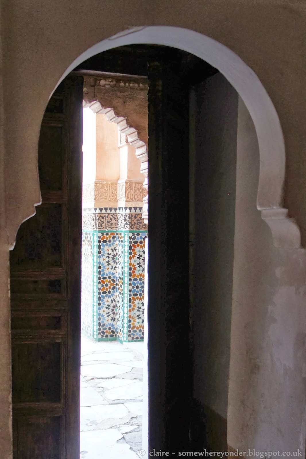 Open door and geometric patterns at Ben Youssef Madrasa, Marrakech