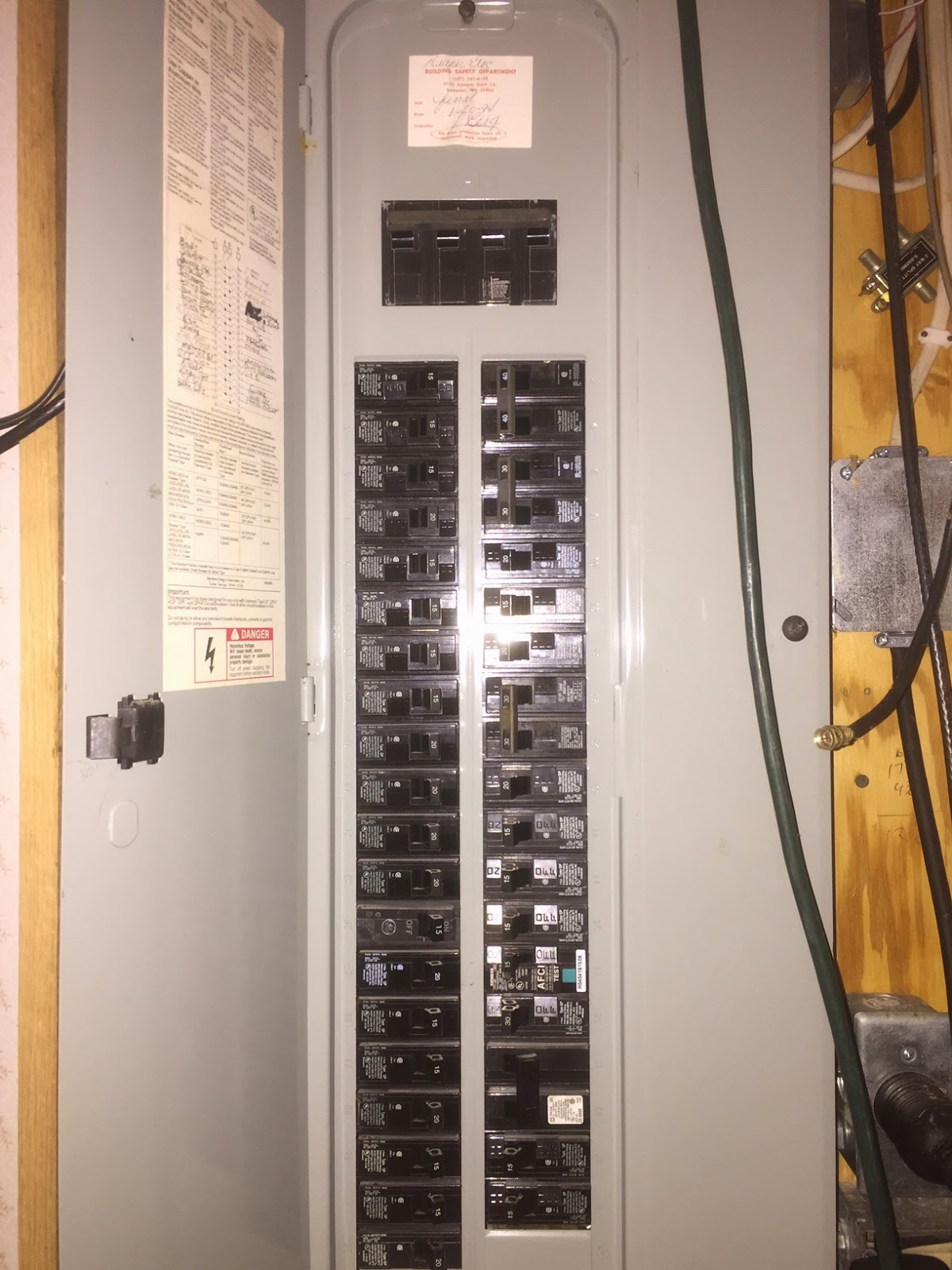 We walked down to the furnace room, and I introduced her to the fuse box:
