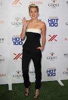 Miley Cyrus waves to cameras