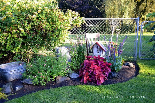 trimmed flowerbed edges / part of summer garden reveal on FunkyJunkInteriors.net