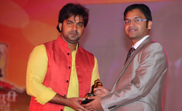 Pawan Singh Taking Award pics.